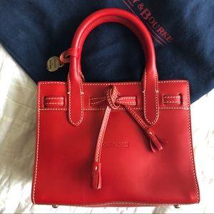 Dooney and Bourke red Alto mini tassel bag dustbag